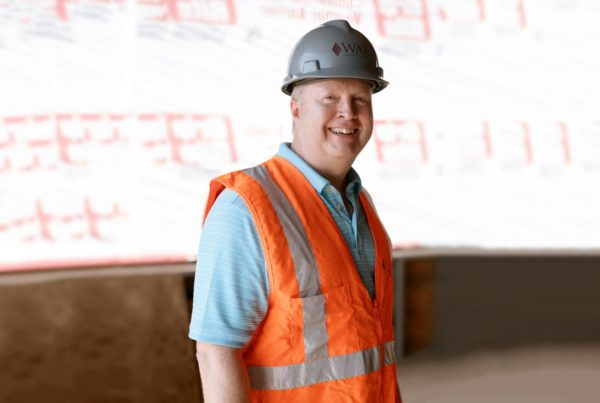 A portrait of Steve Moore standing in the construction area of The Fort Collective.